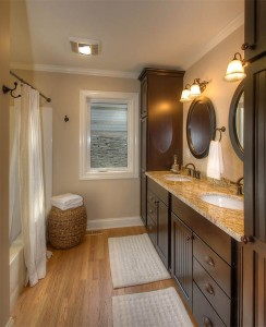 The main level master bathroom with more granite counter tops .
