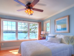 Guest bedroom with a queen bed and beautiful views of the lake.