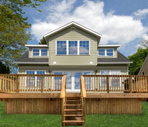 Exterior of the home with a spacious deck with perfect view of the Owasco Lake.