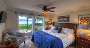 Master bedroom with king bed and stunning lake views.