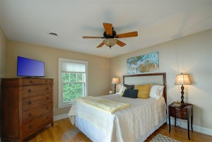 Another view of the first guest bedroom on second level with queen bed.