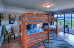 Two sets of full-sized bunk beds on lower level with lake views.