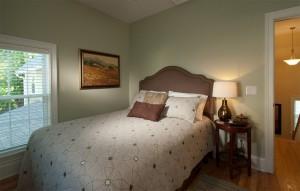 Guest bedroom with queen bed .