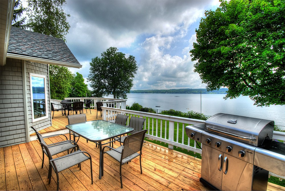 Enjoy a meal and the beautiful view on the ample deck.