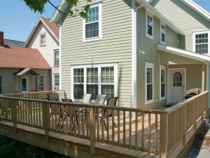 Rear view of home with deck .