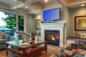 Relax by the gas fire place in the living room .