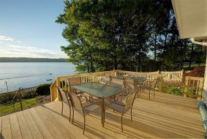 Relax and enjoy on the deck with seating for twelve .