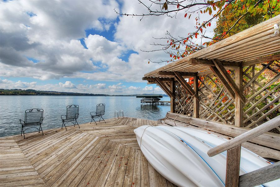 Enjoy the dock with a book and a drink on  Skaneateles Lake.