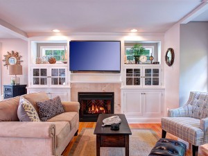 Relax in the cozy living room area with a gas fire place.