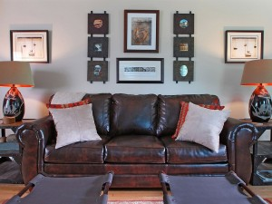 Another view of the living room with leather couch .