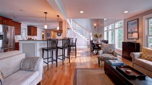 Open concept floor with living, dining, and kitchen.
