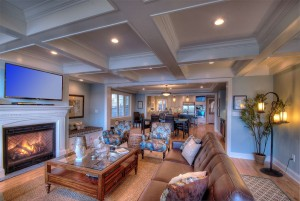 The open floor plan includes living room, dining, and kitchen .