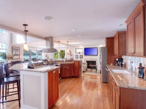 Spacious custom kitchen with island which has seating for eight people.