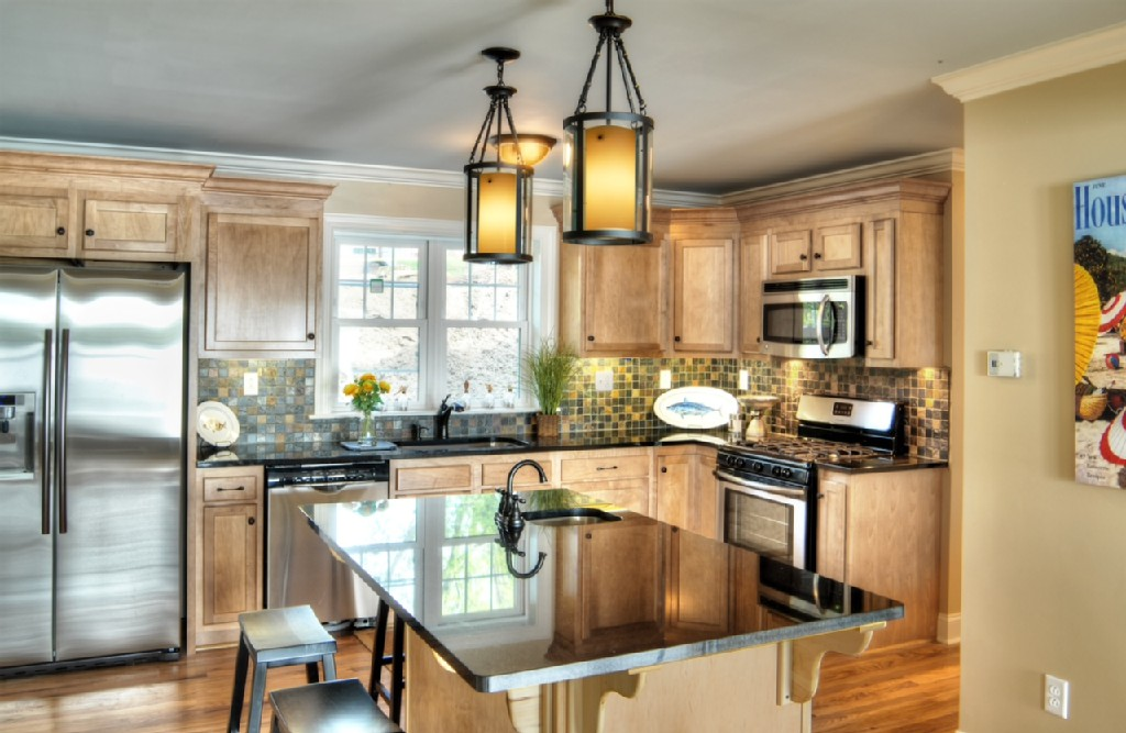 Gorgeous kitchen with black granite countertops with seating for 10 people.