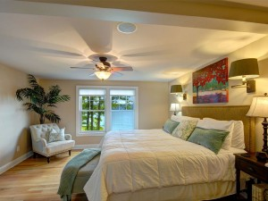 Master Bedroom on the main level with Skaneateles Lake views .