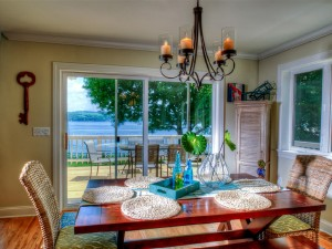 Dining room seats up to 8 people and has amazing views of the lake.