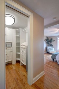 Master bedroom custom walk-in closet .