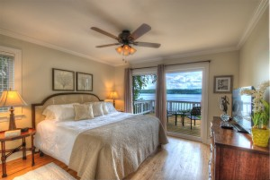 Guest bedroom with king bed on main level and lake views.