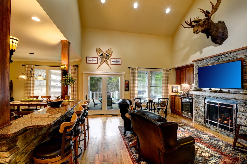 Kitchen Island with seating for four and beautiful wet bar and wine refrigerator