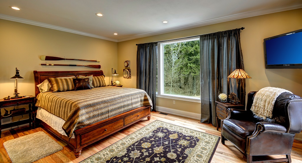 Understated elegance in our stately main level master bedroom suite