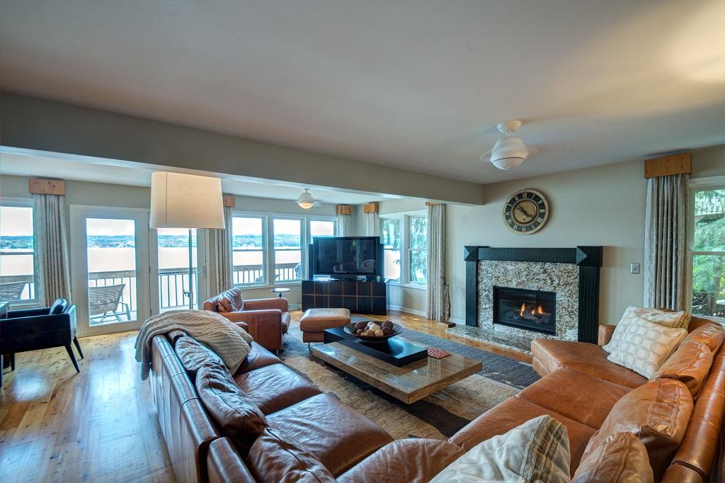 Modern, spacious main level living room with lake views