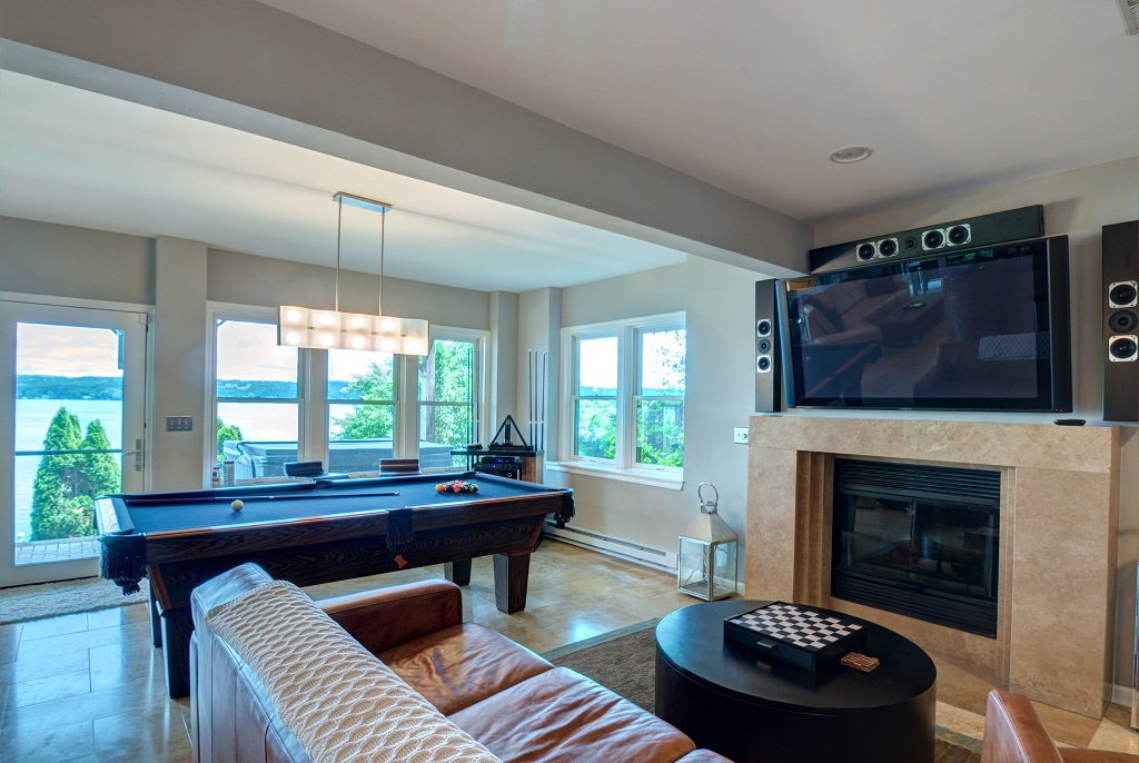 Enjoy a game of pool or chess in the lower level living room