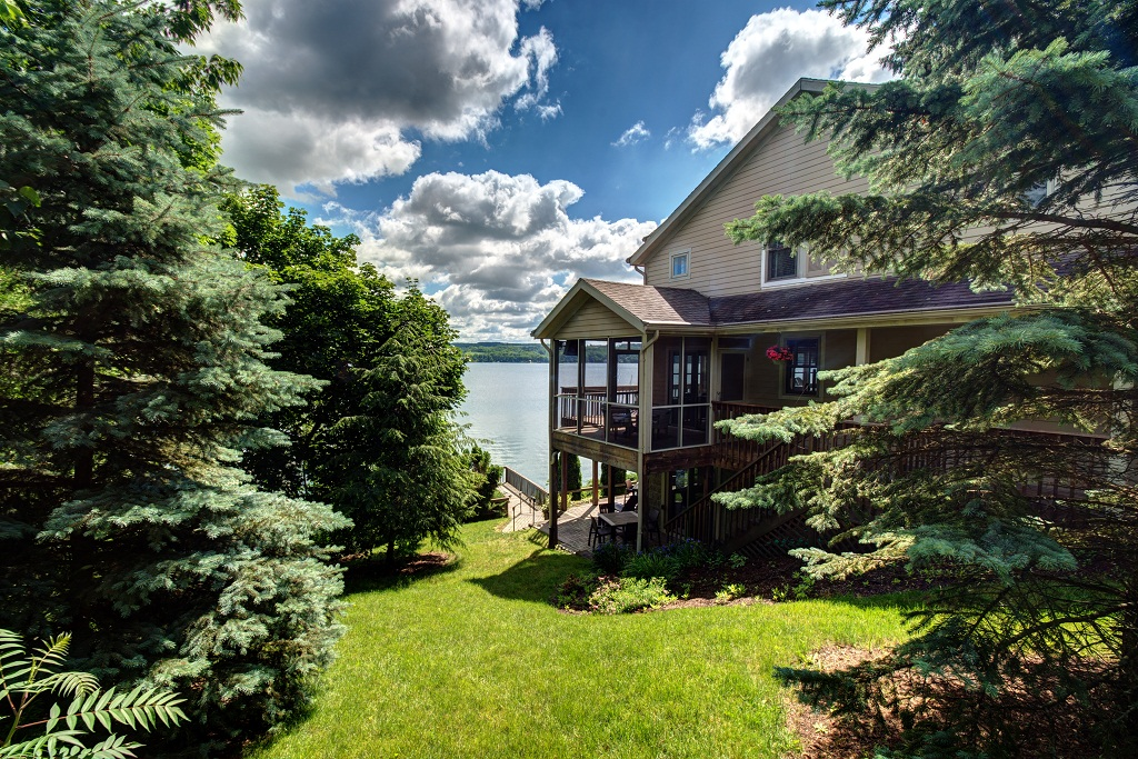 Side yard with a view of Skaneateles Lake
