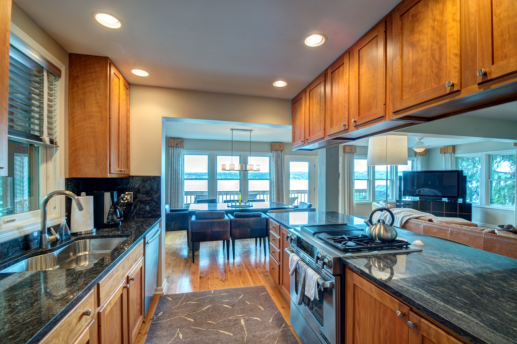 Well appointed kitchen with granite counters on main level