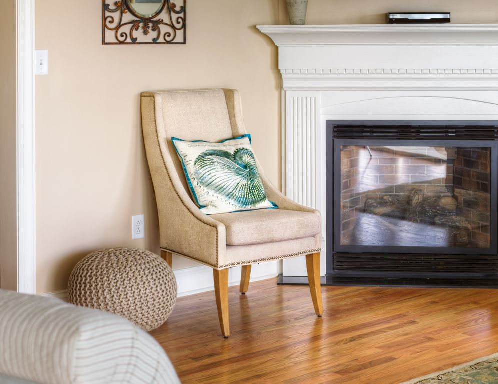 A cozy chair near the gas fire place