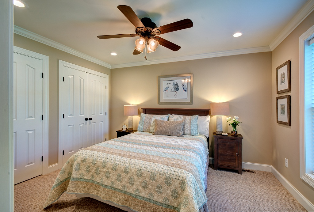 Elegant main level guest bedroom with queen bed