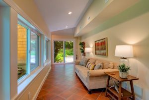 Main level sitting porch with heated floors overlooking creek!