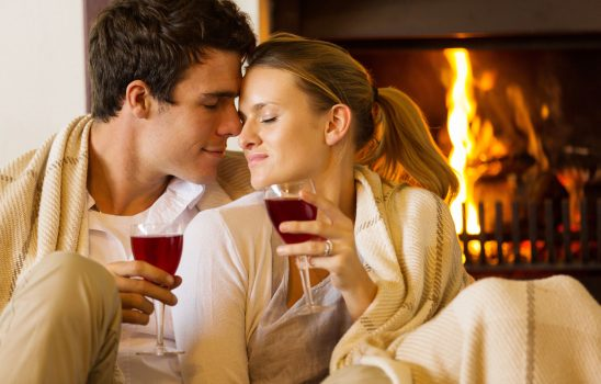 Romantic-Couple-in-Front-of-Fireplace-with-Wine